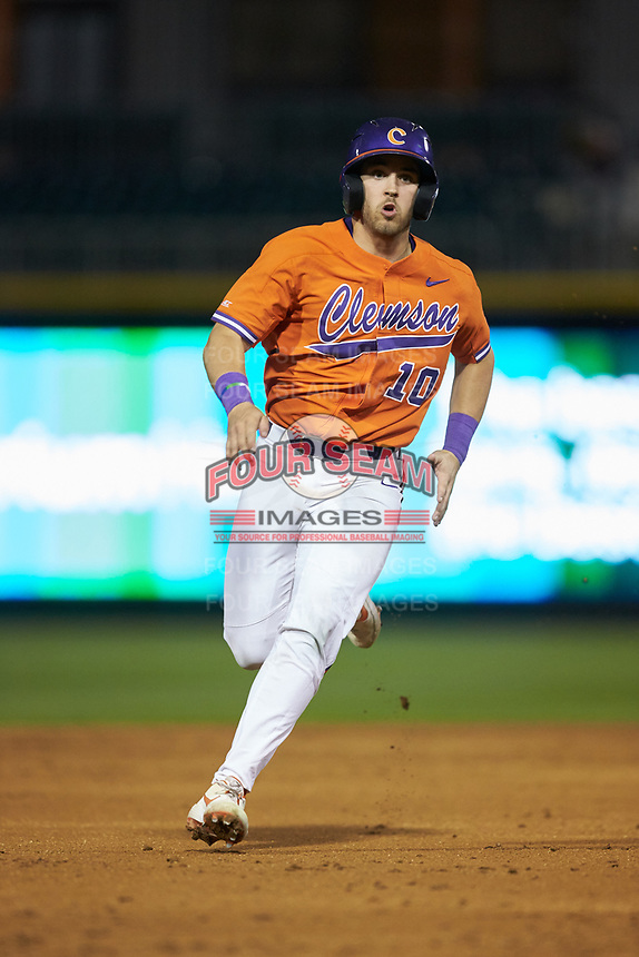 Kyle Wilkie (10) of the Clemson Tigers hustles towards third base against the Charlotte 49ers at BB&T BallPark on March 26, 2019 in Charlotte, North Carolina. The Tigers defeated the 49ers 8-5. (Brian Westerholt/Four Seam Images)
