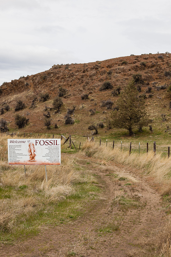 The fossil town sign is seen along an old dirt road in Wheeler County, Oregon.