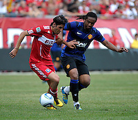 Chicago Fire midfielder Sebastian Grazzini (10) attempts to hold off Manchester United midfielder Anderson (8).  Manchester United defeated the Chicago Fire 3-1 at Soldier Field in Chicago, IL on July 23, 2011.