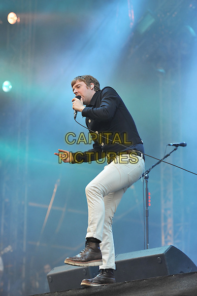 Ricky Wilson of Kaiser Chiefs .Performing live at Hard Rock Calling, Hyde Park London, England, UK, .June 24th 2011..music festival concert gig on stage full length microphone singing black shirt belt white trousers .CAP/MAR.© Martin Harris/Capital Pictures.