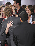Keith Urban & Nicole Kidman say hello to Simon Baker at The 52nd Annual GRAMMY Awards held at The Staples Center in Los Angeles, California on January 31,2010                                                                   Copyright 2009  DVS / RockinExposures