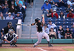 Albuquerque Isotopes' Dustin Garneau hits a grand slam against the Reno Aces in Reno, Nev., on Saturday, April 18, 2015. The Isotopes won 9-4. <br /> Photo by Cathleen Allison