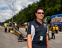 Jun 17, 2017; Bristol, TN, USA; Papa Johns Pizza founder John Schnatter , sponsor of NHRA top fuel driver Leah Pritchett during qualifying for the Thunder Valley Nationals at Bristol Dragway. Mandatory Credit: Mark J. Rebilas-USA TODAY Sports