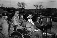 Lt. Gen. Matthew Ridgeway; Maj. Gen. Doyle Hickey; and Gen. Douglas MacArthur, Commander in Chief of U.N. Forces in Korea, in a jeep at a command post, Yang Yang, approximately 15 milies north of the 38th parallel, April 3, 1951.  Grigg. (Army)