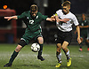 Nick Tagios #9 of Wheatley, right, and John Driscoll #12 of Carle Place battle for possession during the first half of the Nassau County varsity boys soccer Class B final at Hofstra University on Wednesday, Oct. 25, 2017. Tagios scored twice in the second half to lead the Wildcats to a 3-0 win.