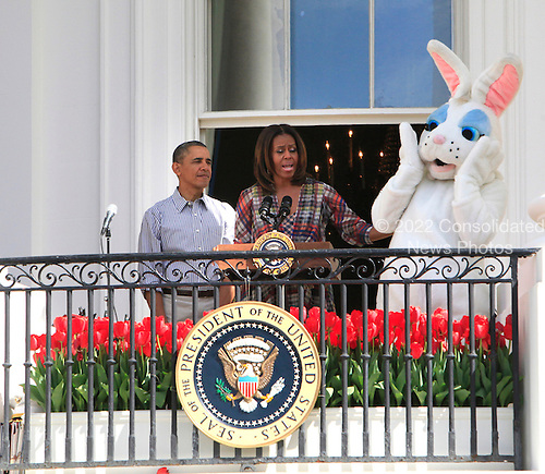 United States President Barack Obama and first lady Michelle Obama participate in the annual Easter Egg Roll on the South Lawn of the White House on April 21, 2014. <br /> Credit: Dennis Brack / Pool via CNP