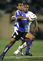 2 April 2005: Ronald Cerritos of Earthquakes dribbles the ball away from Revolution defender during the second half of the game at Spartan Stadium in San Jose, California.   Earthquakes tied Revolution, 2-2.  Credit: Michael Pimentel / ISI