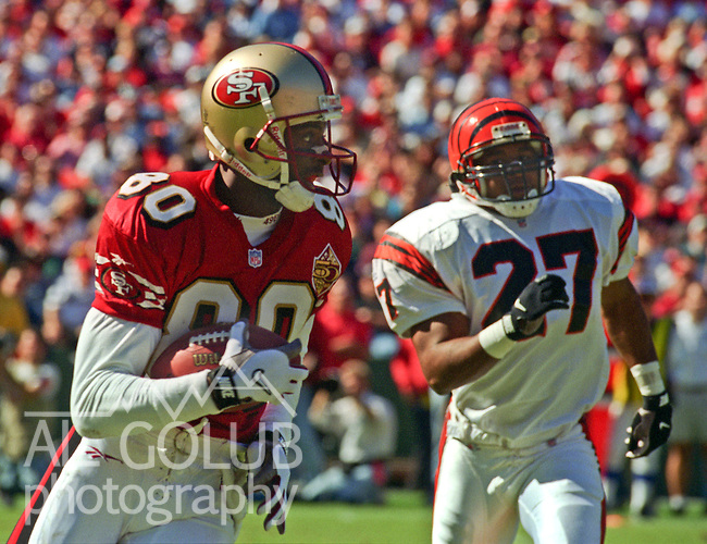 San Francisco 49ers vs. Cincinnati Bengals at Candlestick Park Sunday, October 20, 1996.  49ers beat Bengals  28-21.  San Francisco 49ers wide receiver Jerry Rice (80) and Cincinnati Bengals defensive back Bracy Walker (27).