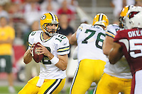 Aug. 28, 2009; Glendale, AZ, USA; Green Bay Packers quarterback (12) Aaron Rodgers drops back to pass against the Arizona Cardinals during a preseason game at University of Phoenix Stadium. Mandatory Credit: Mark J. Rebilas-