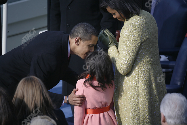 Inauguration of Barack Obama as the 44th President of the United States of America. With his family after taking the oath of office, wife Michelle, daughters; Malia (blue) and Sasha (orange) Washington, D.C., January 20, 2009