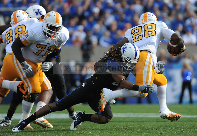 UK Linebacker Winston Guy tackles Tennessee Running Back Tauren Poole during the third quarter of the University of Kentucky football game against Tennessee at Commonwealth Stadium in Lexington, Ky., on 11/26/11. UK won the game 10-7. Photo by Bob Weaver | Staff