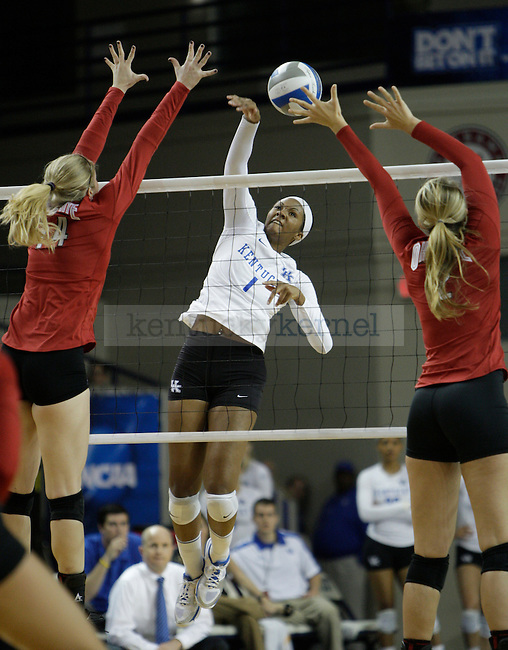 Junior Whitney Billings (1) spikes the ball during the UK women's volleyball game v. Ohio University during the second round of the NCAA tournament in Memorial Coliseum in Lexington, Ky., on Saturday, December 1, 2012. Photo by Genevieve Adams | Staff