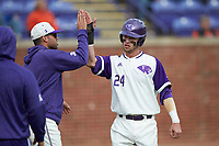 Conner Dunbar (24) of the High Point Panthers is greeted by a teammate after scoring a run against the Campbell Camels at Williard Stadium on March 16, 2019 in  Winston-Salem, North Carolina. The Camels defeated the Panthers 13-8. (Brian Westerholt/Four Seam Images)