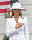 First lady Melania Trump listens to the National Anthem as she and United States President Donald J. Trump host an arrival ceremony for President Emmanuel Macron of France and his wife, Brigitte Macron, on the South Lawn of the White House in Washington, DC on Tuesday, April 24, 2018.<br /> Credit: Ron Sachs / CNP