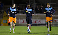 Jermaine Udumaga (centre) of Wycombe Wanderers warms up during the Sky Bet League 2 rearranged match between Bristol Rovers and Wycombe Wanderers at the Memorial Stadium, Bristol, England on 1 December 2015. Photo by Andy Rowland.