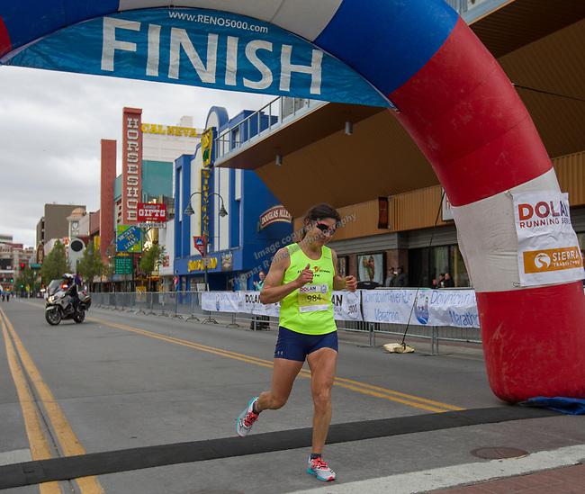 Marathon winner Ramona Sanchez crosses the finish line of the Downtown River Run held in Reno, Nevada  on Sunday April 29, 2018.