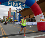 Marathon winner Ramona Sanchez crosses the finish line of the Downtown River Run held in Reno, Nevada  on Sunday April 29, 2018.