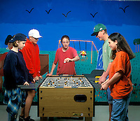 Group of teens playing fuse ball