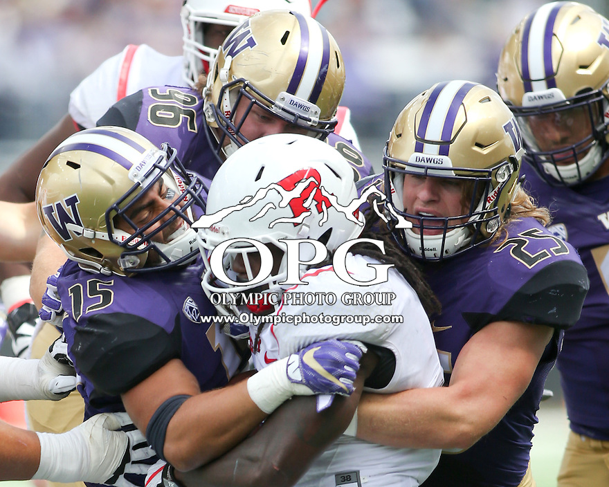 03 September 2016:  Rutgers running back #8 Josh Hicks gets wrapped up for a loss of yardage by Washington's #15 DJ Beavers, #96 Shane Bowman and 25 Ben Burr-Kirven.  Washington defeated Rutgers 48-13 at the University of Washington in Seattle, WA.