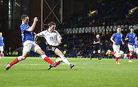 Nicky Clark shoots to score a dramatic late equaliser in the Rangers v Queen of the South Quarter Final match in the Ramsdens Cup played at Ibrox Stadium, Glasgow on 18.9.12.
