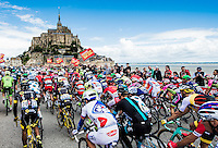 Picture by Alex Broadway/ASO/SWpix.com - 02/07/2016 - Cycling - Tour de France 2016 - Stage One - Mont-Saint-Michel to Utah Beach Sainte-Marie-du-Mont - The peloton passes Mont-Saint-Michel.<br />