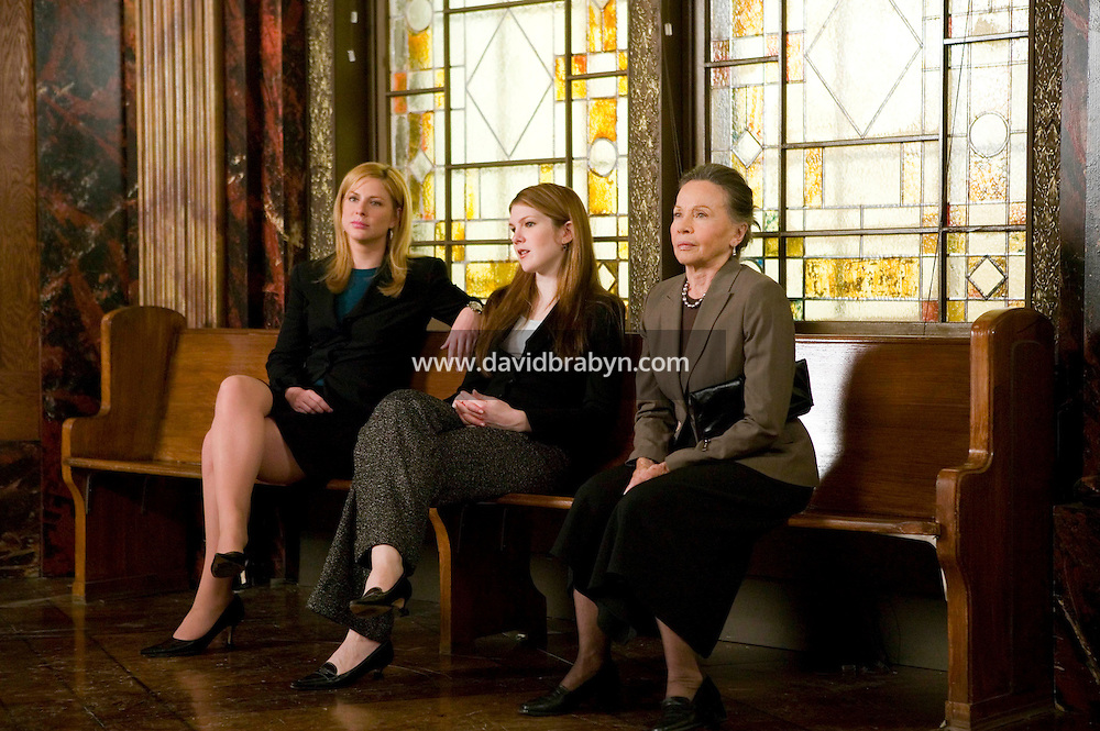"8 May 2006 - North Bergen, NJ - Actresses Leslie Caron (R), Lily Rabe (C), Diane Neal wait between takes on the studio set of television show ""Law & Order: SVU"" in North Bergen, USA, 8 May 2006. In this rare appearance in front of American television cameras, Caron, 74, plays a French victim of past sexual molestation in an episode entitled ""Recall"" due to air in the fall. Caron starred in Hollywood classics such as ""An American in Paris"" (1951), ""Lili"" (1953), ""Gigi"" (1958). More recently she appeared in ""Chocolat"" (2000) and ""Le Divorce"" (2003). Photo Credit: David Brabyn"