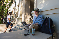 Dylan Bruce '16 uses his laptop outside Johnson Hall, Feb. 9, 2016.<br /> (Photo by Marc Campos, Occidental College Photographer)