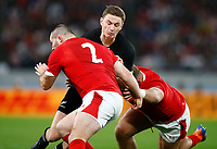 Ken Owens of Wales tackling Beauden Barrett of New Zealand (All Blacks) during the 2019 Rugby World Cup bronze final match between New Zealand All Blacks and Wales at the Tokyo Stadium at the Tokyo Stadium in Tokyo, Japan on Friday, 1 November 2019. Photo: Steve Haag / stevehaagsports.com