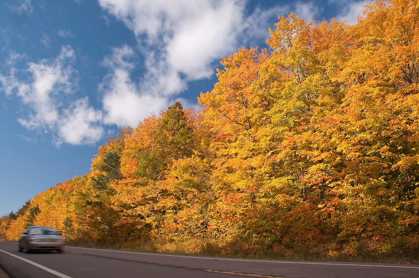 Vehicles and fall color in Hiawatha National Forest of Michigans Upper Peninsula.