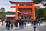 Tourists at the the Main gate, Romon, of Fushimi Inari Taisha head shrine in Fushimi Ward, Kyoto, Japan 2017