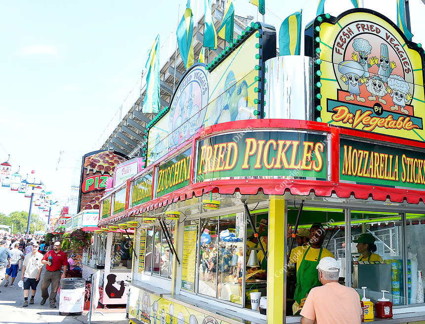 People enjoy fried food of infinite variety at the 2015 Wisconsin State Fair on Thursday, August 6, 2015 in West Allis, Wisconsin