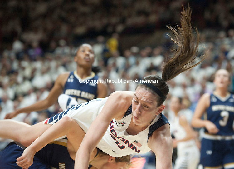 STORRS, CT--- -12015JS06--UConn's Breanna Stewart (30) gets upended while driving to the basket during their game against Notre Dame Saturday at Gampel Pavilion in Storrs. <br /> Jim Shannon Republican-American