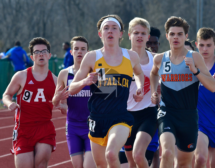 O'Fallon's Jacob Ramirez (center) won the first heat of the 1600 meter run at the Norm Armstrong Boys Track and Field Invitational on Wednesday April 11, 2018. Photo by Tim Vizer