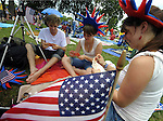 (Boston 070412) Passing the time a day, a group of French tourist play cards while showing of their red white and blue as they to celebrate America's birthday, Wednesday afternoon on the Boston Esplanade. Seen here are, Anais Plantaz, and her sister Manon  and Leo Pierre. (Jim Michaud Photo) 070412) Fro Monday