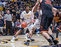 California's Tyrone Wallace working his way for the basket during game against USC at Haas Pavilion in Berkeley, California on February 23th, 2014. California defeated USC 77 - 64