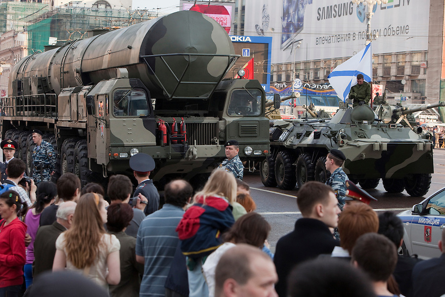 Moscow, Russia, 09/05/2010..Crowds gather in the early morning to watch Russian military vehicles and weaponry, including a Topol-M intercontinental ballistic missile, on their way through central Moscow to Red Square for the Victory Day parade, the largest ever.
