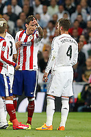 Real Madrid's Spanish defense Sergio Ramos and Atletico Madrid´s Croatian forward Mario Mandzukic