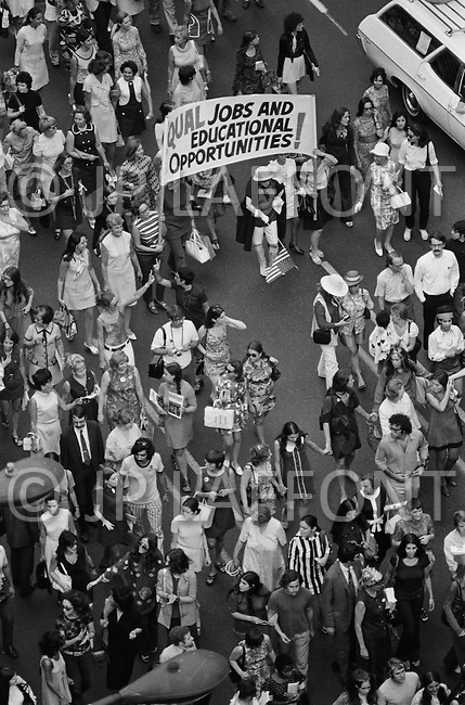 26 Aug 1970 --- Feminists march in New York City on August 26, 1970 on the 50th anniversary of the passing of the Nineteenth Amendment which granted American women full suffrage. The National Organization for Women (NOW) called upon women nationwide to strike for equality on that day. --- Image by © JP Laffont