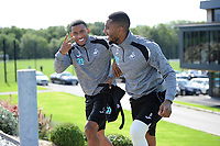 Luciano Narsingh (left) and Leroy Fer (right) of Swansea City walk to the pitch during the Swansea City Training at The Fairwood Training Ground, Swansea, Wales, UK. Friday 24 August 2018