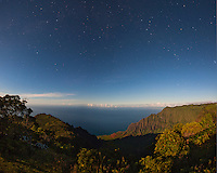 Starry sky over Kalalau Valley as viewed from the Kalalau Lookout, Kauai