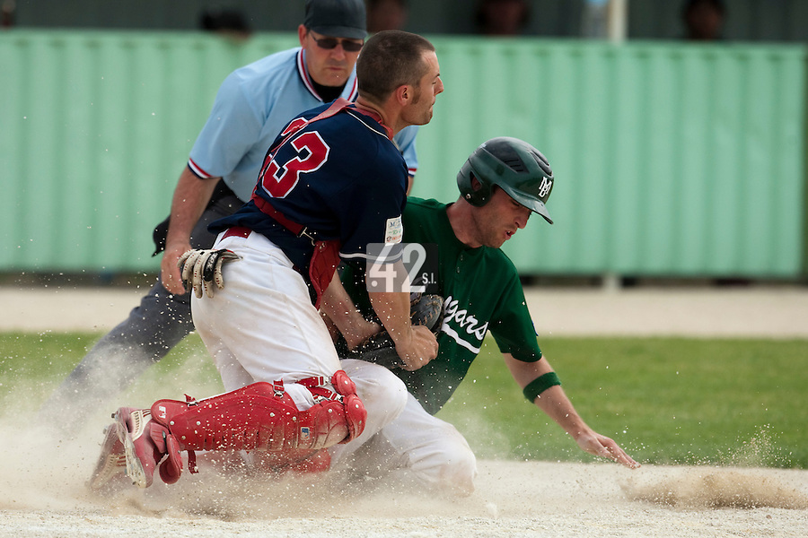 22 May 2009: Alexandre Couton of Montigny slides at home against Fabrice Morlier of La Guerche during the 2009 challenge de France, a tournament with the best French baseball teams - all eight elite league clubs - to determine a spot in the European Cup next year, at Montpellier, France.