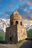 Pictures & images of Gergeti Holy Trinity (Tsminda Sameba) Georgian Orthodox and Apostolic Church bell tower, 14th century, Gergeti, Khevi province, Georgia (country). At Sunset.