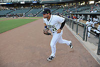 Left fielder Zach Rheams (23) of the Columbia Fireflies is introduced before a game against the Charleston RiverDogs on Tuesday, August 28, 2018, at Spirit Communications Park in Columbia, South Carolina. Columbia won, 11-2. (Tom Priddy/Four Seam Images)