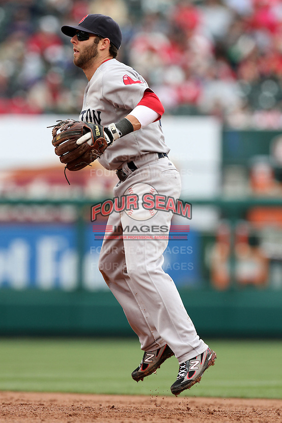 Dustin Pedroia #15 of the Boston Red Sox in the field against the Los Angeles Angels at Angel Stadium in Anaheim, California on April 24, 2011. Photo by Larry Goren/Four Seam Images