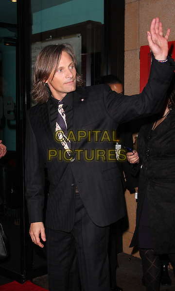 "VIGGO MORTENSEN .Attending the Times BFI 53rd London Film Festival UK Premiere of ""The Road"" at the Vue West End, Leicester Square, London, England, October 16th 2009.half length black suit tie hand waving striped print .CAP/ROS.©Steve Ross/Capital Pictures"