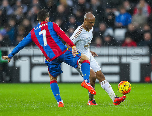 06.02.2016. Liberty Stadium, Swansea, Wales. Barclays Premier League. Swansea versus Crystal Palace. Swansea City's Andre Ayew passes the ball despite being under pressure from Crystal Palace Yohan Cabaye