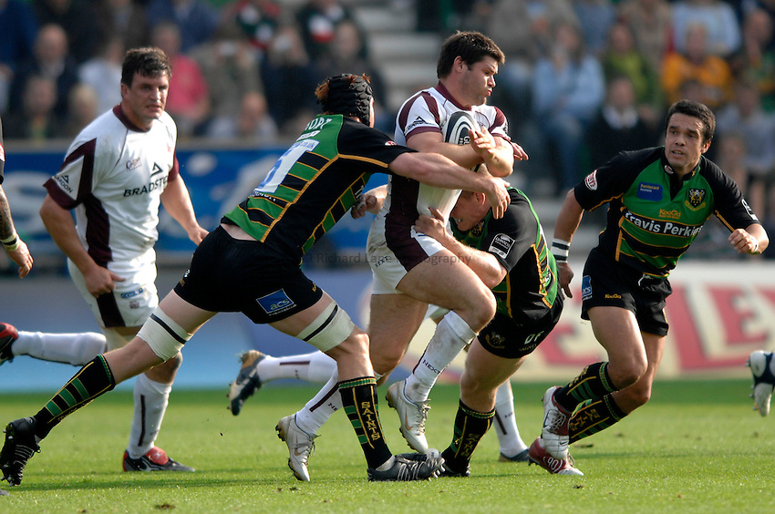 Photo: Richard Lane..Northampton Saints v Leicester Tigers. Guinness Premiership. 14/10/2006. .Tigers' Dan Hipkiss attacks as Christian Short tackles.