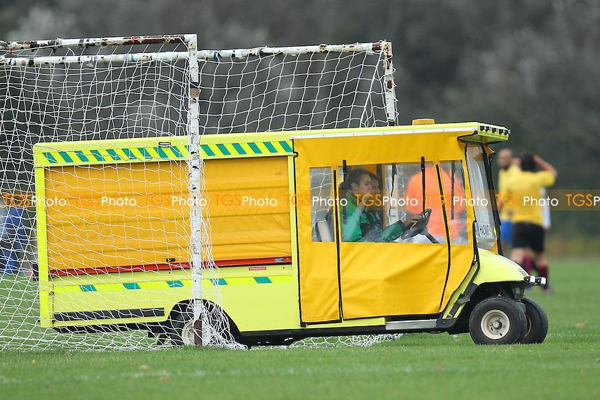 An ambulance passes the pitch - Riviera (blue) vs Athletico Angels - Hackney & Leyton Sunday League Football at South Marsh, Hackney , London - 26/10/14 - MANDATORY CREDIT: Gavin Ellis/TGSPHOTO - Self billing applies where appropriate - contact@tgsphoto.co.uk - NO UNPAID USE