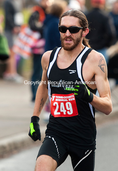 WATERBURY, CT--- -112215JS04--Will Sanders of Wethersfield broke a course record in the 5-mile course with a time of 24:50, during annual Fischang-Cicchetti Road Race in Waterbury on Sunday. Jim Shannon Republican-American