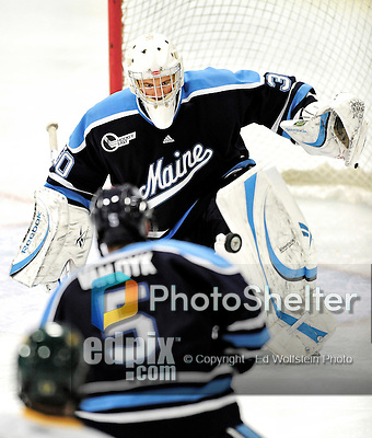 30 October 2010: University of Maine Black Bears' goaltender Dan Sullivan, a Freshman from York, PA, makes a third period save against the University of Vermont Catamounts at Gutterson Fieldhouse in Burlington, Vermont. The Black Bears defeated the Catamounts 3-2 in sudden death overtime. Mandatory Credit: Ed Wolfstein Photo